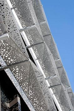 Only on closer inspection you notice just how elaborate the perforated and embossed metal sheets are that RMIG makes available to architects.