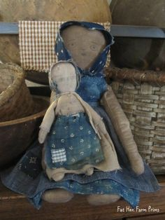 """Fat Hen Farm - Primitive Rag Dolls - Early Blue Calico...This pair is sweet and a little patriotic!   Lot's of wonderful blue calico here!  They are completely sewn by hand with early fabric, rag stuffed and have a nice weight. Approx. 14"""" & 7"""" tall."""