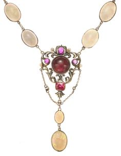 An opal, pink tourmaline, seed pearl and diamond necklace  enclosed compartment behind center stone; mounted in rhodium-plated fourteen karat gold and silver; length: 21in.