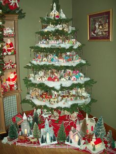 This is the putz tree for 2011. The cardboard houses from the 1930-1970's