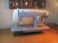Kenmore Sewing Machine Model 158 523 Heavy Metal Machine   eBay (I have also seen a variation w/ 2 spool pins)