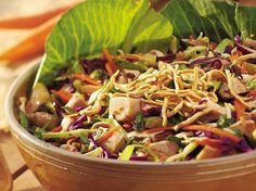 bettycrocker.com  Ingredients  2 cups chopped cooked chicken 2 cups shredded green cabbage 2 cups shredded red cabbage 1 cup shredded carrot (1 large) 1/4 cup sunflower nuts 1/2 cup low-fat Asian sesame-ginger dressing 1/2 cup chow mein noodles  Directions 1 In large bowl, place all ingredients except dressing and noodles. 2 Pour dressing over salad; toss to coat. Garnish with noodles.  Go here for tips and