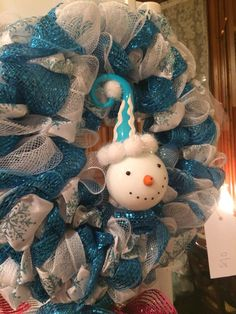 Snowman wreath. Blue and white deco mesh with blue snowflake wire ribbon