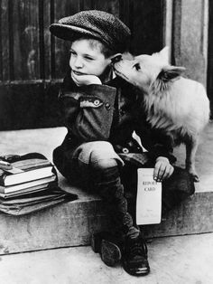 October 25, 1949: Detroit, Michigan: A schoolboy being comforted by a puppy photographed by Lou Gardner. The image won first prize in an amateur photo contest held during the 1949 National Dog Week.