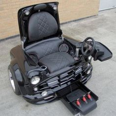 Mini Cooper Chair. The only thing that could make this any cooler was if I could actually drive around in it. :-)