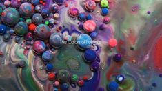 Paint, Oil, Milk, and Honey Mix in this Surreal Macro Video of Swirling Liquids by Thomas Blanchard.