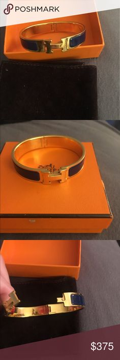 Hermes signature thin H clic clac bracelet 100% Authentic Hermes h clic clac bracelet. Gold with navy blue enamel. Comes with pouch and box Hermes Jewelry Bracelets