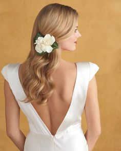 If your style is more sleek and streamlined, secure two blooms -- in this case, gardenias -- together with floral wire, then tuck them behind your ear with bobby pins.