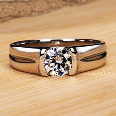 Our impressive ruby engagement ring set, from Camellia Jewelry, will take her breath away. Custom handcrafted in the finest detail, this flower engagement ring features a round cut ruby stone beautifully set in a solid white & rose gold floral setting Diamond Studs, Diamond Rings, Mens Diamond Jewelry, Mens Diamond Bracelet, Gents Ring, Gold Ring Designs, Solitaire Ring Designs, Mens Ring Designs, Engagement Rings For Men
