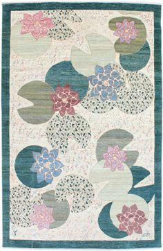 F412-4487 a deco-inspired rug in green inspired by lily pads.