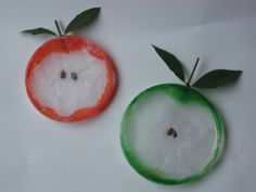 Make adorable apple slice from a recycled plastic lid.