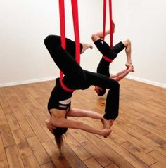 Aerial or Anti-Gravity Yoga...I am DYING to try this!!!