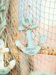 Light blue anchor escort card idea for a nautical wedding