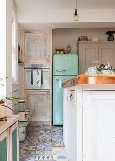 Idk how I feel about the entire kitchen... but I really like the floor tiles & THE FRIDGE IS LIGHT BLUE/TURQUOISE OMG WHAT :3