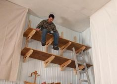 Way-up-high cantilevered garage shelves - For the Home - Way-up-high cantilevered garage shelves - Diy Overhead Garage Storage, Garage Storage Shelves, Garage Storage Solutions, Diy Garage Storage, Garage Shelf, Garage Organization, Build Shelves, Tool Storage, Storage Ideas