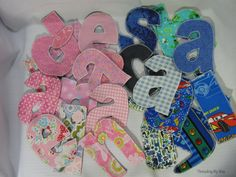 Fabric Letters - Make a set containing the letters of each child's name then tie them together with a ribbon. This would make a cute gift!