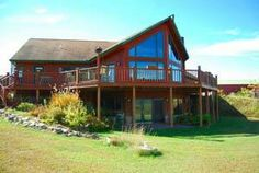 Beautiful views abound from this Cedar chalet resting on 34.5 acres! Expansive great room, hardwood & tile flooring, main level master bed/bath. Finished walk-out LL, two fireplaces, 4BR/3BA, 3C att. garage, 40' pole building. Wrap around deck, horseshoe pits & so much more.  A must see Wisconsin country home.  $474,900