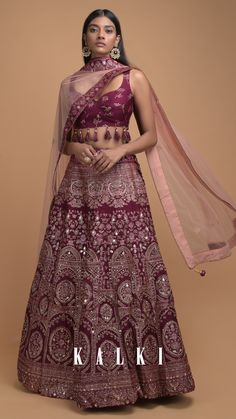 This constructed burgundy indo-western fancy tassel lehenga promises to be a wardrobe staple witnessing a makeover from regular lehenga to a trendy one and instantly will become a great choice for your bestie's Mehendi party. Celebrities too have validated the style in their recent outfit choices in @kalkifashion. We bet you too want to embrace this heritage-worthy duo! #TheHeritageSeries  KALKI Expert Tip: Let your collarbones shine in this stunner with a braided updo and chandelier… Ethnic Fashion, Modern Fashion, Indian Fashion, Traditional Sarees, Traditional Dresses, Indian Dresses, Indian Outfits, Lehenga Color Combinations, Bollywood Outfits