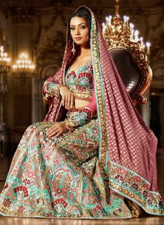 I would rock Indian attire at my wedding. I think their gowns are beautiful.