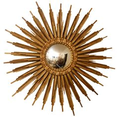 Spectacular Electrified Giltwood Convex Sunburst Mirror | From a unique collection of antique and modern convex mirrors at https://www.1stdibs.com/furniture/mirrors/convex-mirrors/