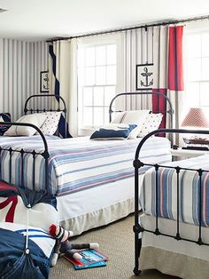Gorgeous nautical bedroom design with three twin beds.