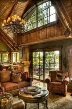 Would love watching the snow through these windows and being comfy cozy on these couches