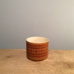 "Vintage Hornsea ""Saffron"" Cup Small  £4.50 Hornsea was wildly popular in the 70's and was produced until the early 90's.  This saffron small cup is the perfect retro vibe for your home!  Dimensions  Height 7cm, Diameter 8cm."