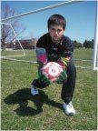 "SOCCER GOALIE HAND POSITIONS High Balls – Catching Above Head The basic position of the hands resembles the letter ""W"". If the hands are too small to keep thumbs together and secu…"
