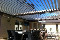 The modern Silencio Louvres by Johnson & Couzins are climate change at your fingertips, providing sun and rain protection at the touch of a button. Climate Change, Pergola, Louvre, Architectural Styles, House Design, Architecture, Outdoor Decor, Modern, Home Decor