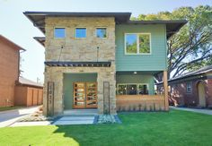 Modern Home Exterior. Cedar Siding · Concrete walkway · Five panel doors · Floating House Numbers · Metal Awning · Metal Edging · Modern Landscape · Random Stack Stone · Reed Grass · Rusted Metal · Tejas Stone