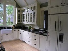Black & white kitchen with beadboard backsplash.
