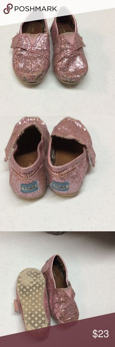 Girls Pink Glitter Tom's Shoes Pre-Loved Tom's shoes for little girl! Shoes are still in pretty good condition and will last for a while. Shoes are pink sparkle in a size 7. TOMS Shoes Sneakers