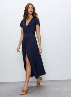 Oh, I just threw this on. This is a long, self-tie wrap dress with short sleeves and a slit to the thigh. It's made with fluid fabric that drapes beautifully. Wrap Dress Short, Wrap Front Dress, Short Sleeve Dresses, Dress Long, Short Sleeves, Wrap Dresses, Navy Midi Dress, Midi Dress With Sleeves, December Wedding Dresses