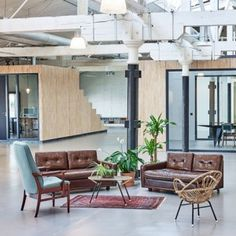 Fairphone's+Amsterdam+offices+built+inside+an+old+warehouse+using+reclaimed+materials