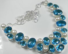 Gemstone : Faceted Blue Topaz, Pearl,,Length : 18 Inches,,Total Weight: 156 gms  Our Price 29.99 $USD