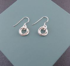 Take a look at my listing, folks👇 Sterling Silver Love Knot Earrings, chainmaille flower, eternity, silver circle earrings, 3 rings, minimalist, three circles, chain mail https://www.etsy.com/listing/499504980/sterling-silver-love-knot-earrings?utm_source=crowdfire&utm_medium=api&utm_campaign=api