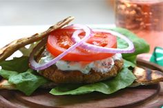 Harissa Chickpea Burgers with Cucumber Mint Yogurt  http://acozykitchen.com/harissa-chickpea-burgers/#