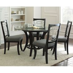 The Cayman Dining Collection brightens the dullest days, with its bold form, fun details and thoroughly modern look. The Cayman dining table features a black wood and metal base topped with a marble ring inset with a decorative metal design.  Top that with the 10mm thick, 48� round glass...