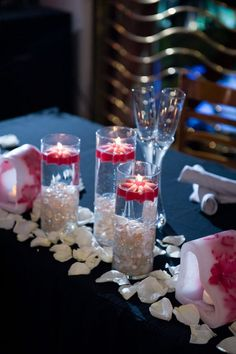 Floating candles and heart-shaped flower embedded luminaries for wedding reception http://www.designbycandlelightaz.com/index.html
