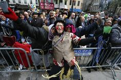 A member of the Mondo Kayo Social and Marching Club dances with parade goers on Mardi Gras in New Orleans, Louisiana February 17, 2015. REUTERS/Jonathan Bachman