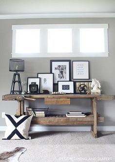 Rustic Modern Family Room Reveal - Modern Rustic Console Table Display/ the long skinny windows are pretty framed out with trim/ pass - Rustic Console Tables, Rustic Table, Rustic Wood, Modern Rustic Decor, Rustic Modern Living Room, Rustic Industrial Bedroom, Industrial Decorating, Industrial Chic Decor, Industrial Wall Art