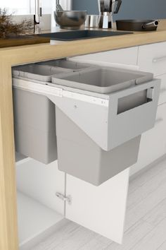 """It's not always possible to hav a fixed drawer style front on a pull out kitchen bin – for example when retrofitting into an existing cupboard. Many Tanova Simplex kitchen bins models have a """"handle"""" style model that is mounted behind a hinged door. Kitchen Cabinet Door Styles, Cupboard Doors, Kitchen Cupboards, Kitchen Bins, Kitchen Decor, Cupboard Ideas, Kitchen Utensils Store, Kitchen Containers, Diy Kitchen Storage"""