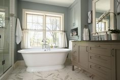 pretty blue and dark brown paint colors with the white trim
