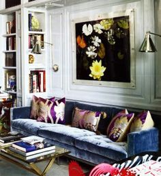 blue velvet sofa and builtin bookcases and mouldings and sconces love
