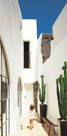 Traditional Outdoor Space by Erin Quiros and James Cavagnari in Salina, Sicily