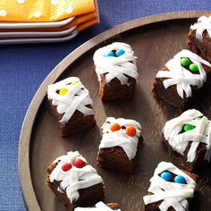 Mummy Brownies Recipe -The grave couldn't hold these mummified treats for long! Watch these fudgy brownies pull a disappearing act at your Halloween get-together. —Taste of Home Test Kitchen