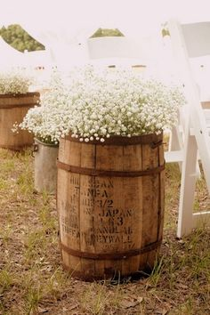 DIY Tip} Obtain whiskey barrels and fill them with bunches of Baby's Breath so that the barrels appear to be overflowing with these lovely flowers. Something suitable can be placed inside each barrel in order to add height to the flowers.| DIY Baby's Breath, Burlap & Lace Wedding Ideas | Confetti Daydreams
