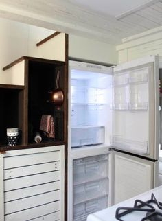 Handcrafted Movement Tiny House 009. Understairs fridge ans storage. Maybe room for a washerdryer?