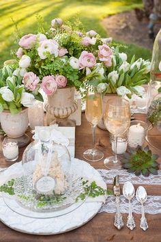 Beautiful combination of rustic and refined - reclaimed wood table, lace, groupings of fresh flowers, cloche, candlelight.