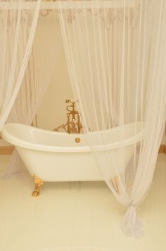 Turn a bathroom into an ideal place for #weekend pampering with a standalone bathtub with draped  lace curtain which invites time-out to unwind with a good book, while soaking in a warm bath.